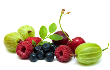 Assorted fresh berries on a white background photo