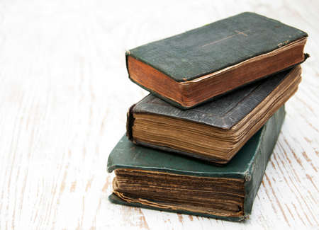 Three very Old Book on a wooden  photo
