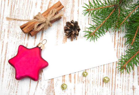 Blank Christmas card or invitation with decorations photo