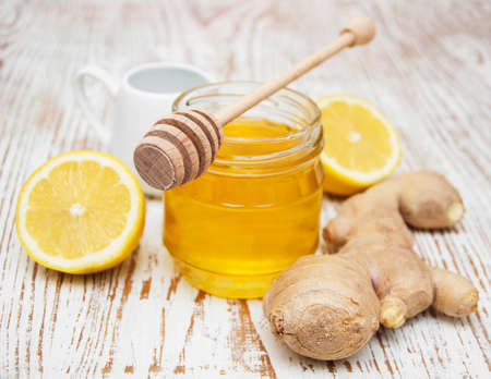 honey,  lemon and ginger on a wooden background 写真素材