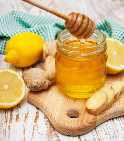 honey,  lemon and ginger on a wooden background Stock Photo