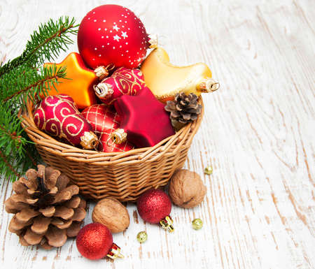 decorating christmas tree: Christmas Decoration in basket on a wooden background