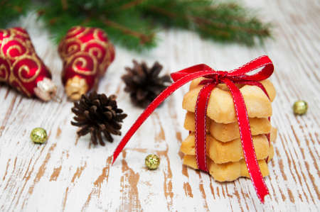 Christmas cookies and pine on a wooden background photo