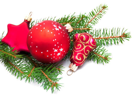 Christmas pine and baubles on a white background photo