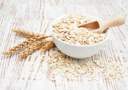 Bowl of oats on a old wooden background