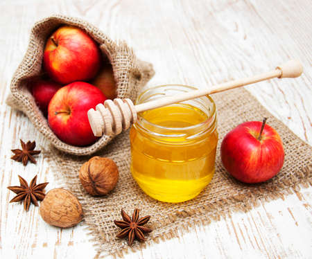 honey apple: fresh honey with  spices and apples on a wooden background