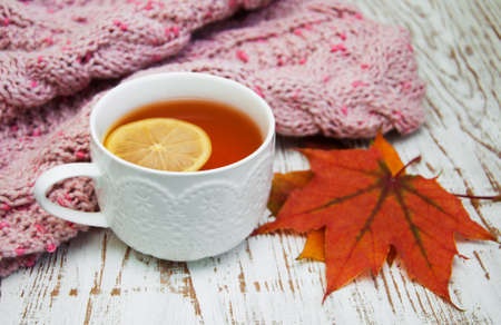 winter leaf: Autumn time: cup of hot tea with lemon and scarf