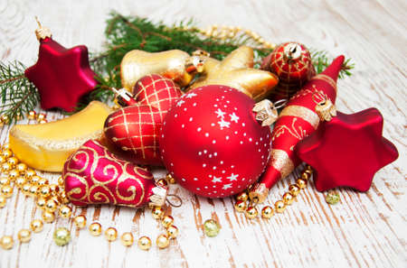 Christmas Pine and Bauble on a wooden background photo