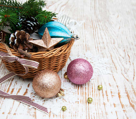 Christmas basket with toys on a wooden  background photo