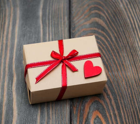 heart white: vintage gift box package  on old wooden background