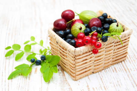 Assorted fresh berries on a wooden  background photo