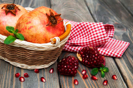 juicy pomegranates on a old wood background