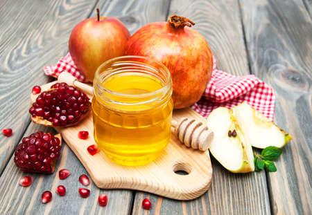 honey apple: honey apple and pomegranate on wooden table