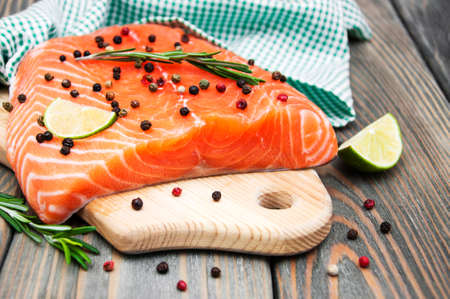 fresh fish: salmon fish with fresh herbs,  lime and pepper