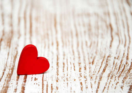 valentine: Red heart on a old wooden  background Stock Photo