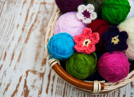 color woolen clews for knitting on a wooden background Stock Photo
