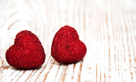 Red hearts on a old wooden  background photo