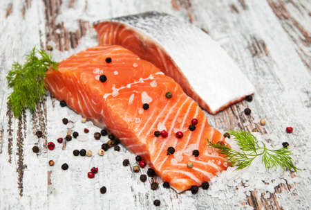 seafood: portions of fresh salmon fillet with aromatic herbs, spices Stock Photo