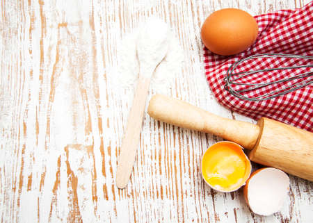 baking background with eggs and rolling pin Imagens