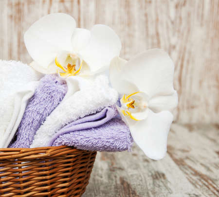 white orchids: spa concept  with  white orchids and  towels