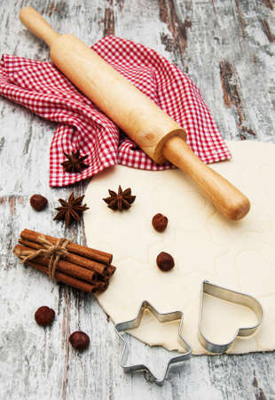 baking background - dough, cookie cutters and spices photo