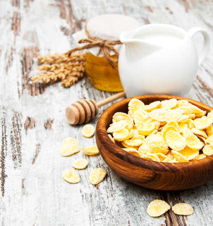 flakes with honey, nuts and milk - healthy breakfast photo