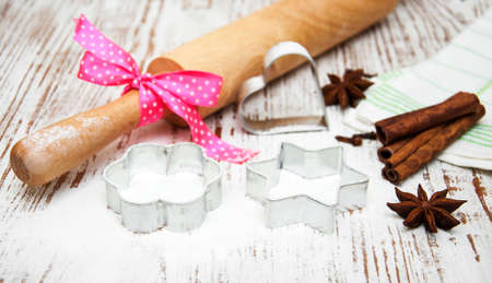 cookie cutter: cookie cutter and rolling pin on a wooden background