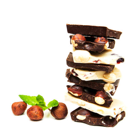 Dark and white chocolate with nuts on a white background photo