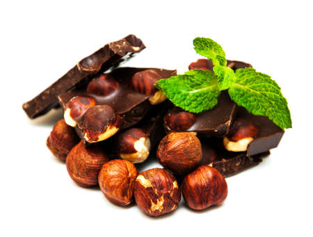 Dark  chocolate with nuts on a white background photo