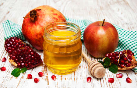rosh: honey  apple and pomegranate on a wooden table