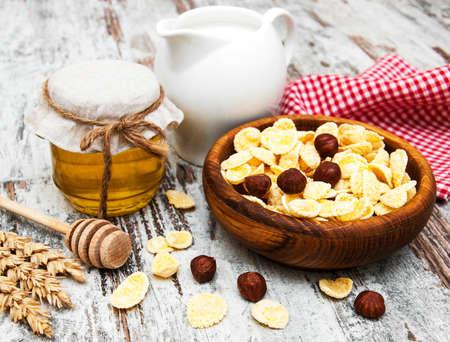 flakes with honey, fruits, nuts and milk - healthy breakfasts photo