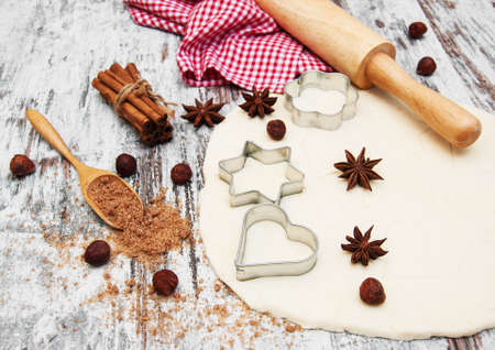 cutters: baking background - dough, cookie cutters and spices