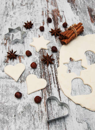 cookie cutters: baking background - dough, cookie cutters and spices