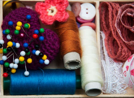 handicrafts: thread and material for handicrafts in box Stock Photo