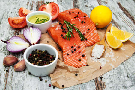 fresh taste: portions of fresh salmon fillet with aromatic herbs, spices and vegetables Stock Photo
