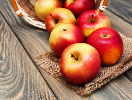 Fresh red apples on a old wooden background photo