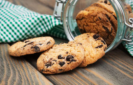 Jar with Chocolate cookies on a wooden background photo