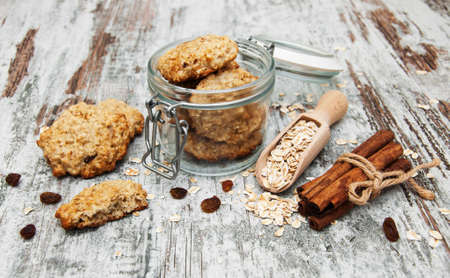 Oatmeal cookies and ingredients on a old wooden background photo