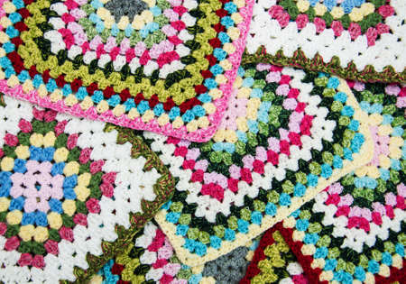 crocheted: multicolored plaid squares of crocheted - close up Stock Photo