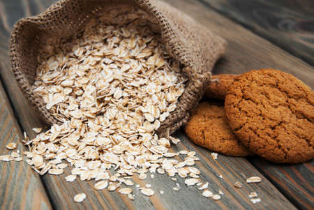 cookies: Oatmeal cookies with oat flakes on a old wooden background