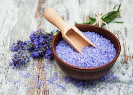 organic plants: Lavender and  massage salt on a old wooden background