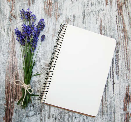 Lavender with notebook on a old wooden background Imagens