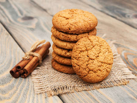 Oatmeal cookies on a old wooden background