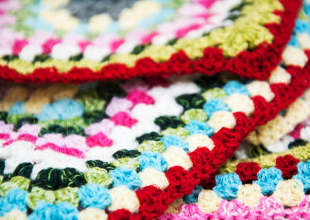 crocheted: multicolored plaid square of crocheted - close up