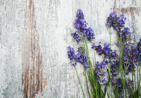 lavender flowers on a old wooden background