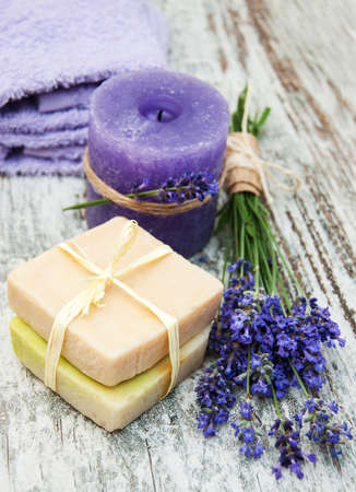 salon background: Lavender, handmade soap and  sea salt  on a wooden background Stock Photo