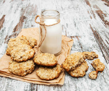 oatmeal cookies and  milk on a old wooden background Stock Photo