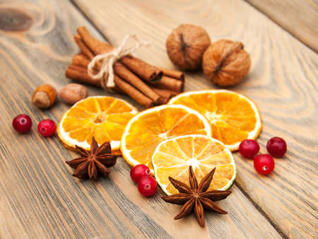 dried orange: different kinds of spices  and dried oranges on a old wooden background
