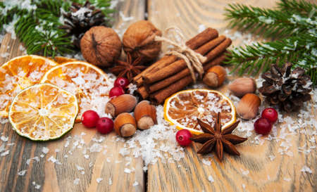 rustic food: different kinds of spices  and dried oranges with christmas tree