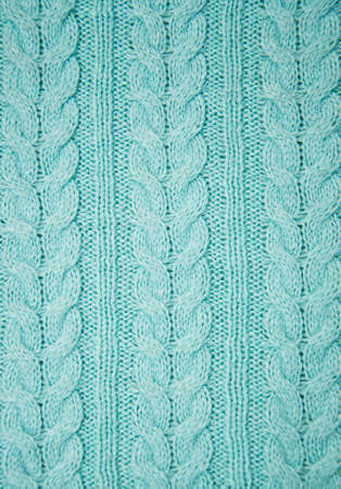 cable knit: knit texture of blue wool knitted fabric with cable pattern as background Stock Photo